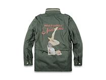 누드본즈(NUDE BONES)의 귀여운 핀업걸이 그려진 재킷